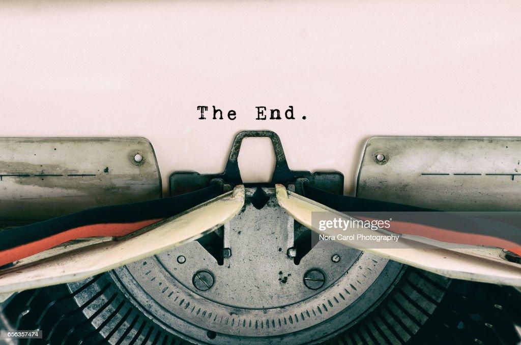 The End words type on Vintage Typewriter : Stock Photo