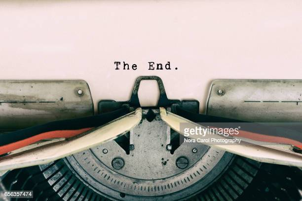 the end words type on vintage typewriter - finishing stock pictures, royalty-free photos & images