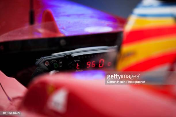 The engine and gear information bright red LED light display on Spanish Scuderia Ferrari Formula One driver Fernando Alonso's steering wheel in the...