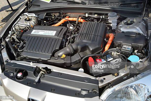 The engine area is visible on a new Honda Civic Hybrid automobile during an exposition at the Motorola campus October 10 2003 in Deer Park Illinois...