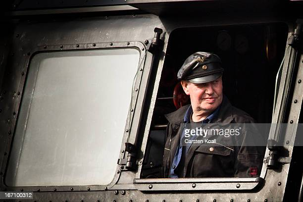 The engine driver Fiete Heilmann looks out the window after the rides the steam engine locomotive of Type 03 produced in Germany during World War II...