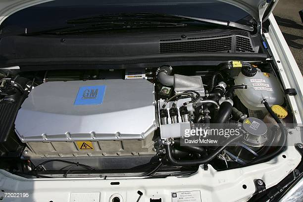 The engine is revealed of a General Motors HydroGen3 fuel cell minivan as officials unveil the new vehicle to be added to the U.S. Postal Service's...