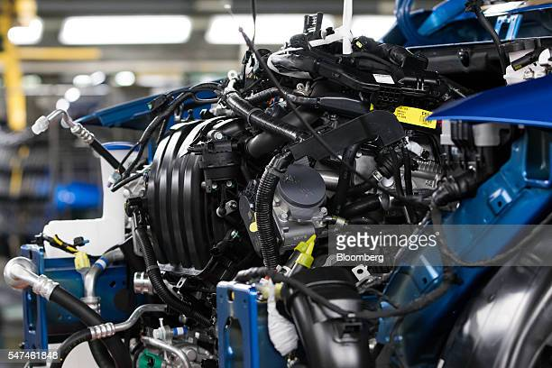 The engine of a Hyundai Motor Co. Elantra vehicle is seen on the production line at the company company's plant in Ulsan, South Korea, on Monday,...