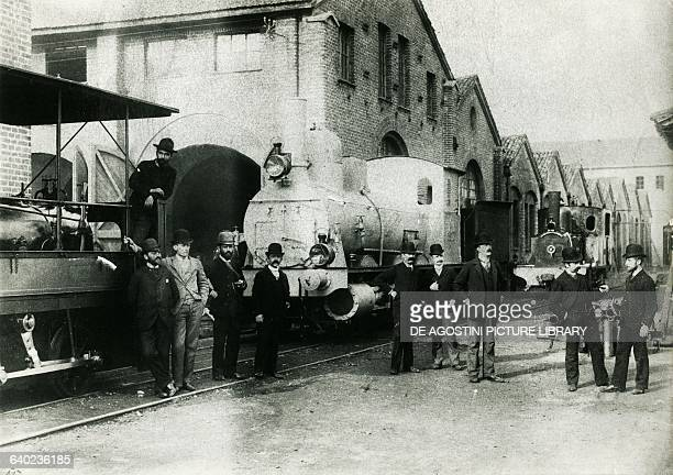 The engineer Ernesto Breda third from right and his coworkers in the Elvetica plant souvenir picture for delivery of a batch of locomotives to...