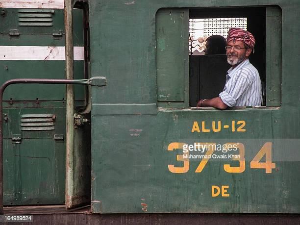 CONTENT] The engineer on the Karakoram Express at Karachi Cantt Sataion Sindh Pakistan
