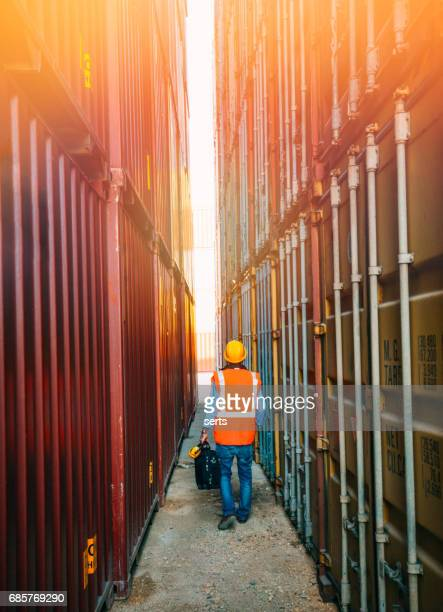 The engineer working with Cargo Containers