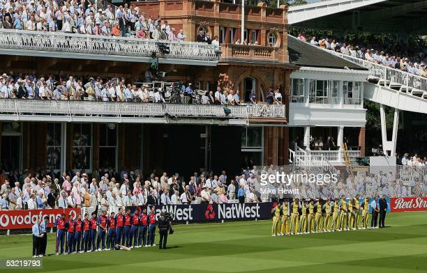 The England and Australian teams stand for a minutes silence in front of The Pavilion in tribute to the victims of the London Bombings during the...