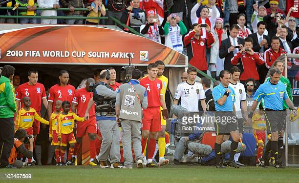 The England and German teams enter the stadium prior to the start of the 2010 FIFA World Cup South Africa Round of Sixteen match between Germany and...