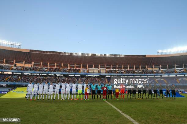 The England and Mexico team line up for the National Anthems ahead the FIFA U17 World Cup India 2017 group F match between England and Mexico at...