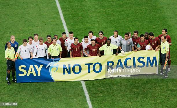 The England and Portugal teams line up behind an anti racism banner prior to the FIFA World Cup Germany 2006 Quarterfinal match between England and...