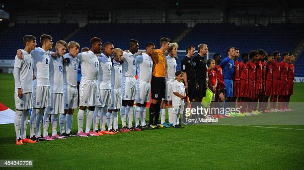 The England and Portugal teams line up for the national anthem prior to the Under 17 International match between England U17 and Portugal U17 at...