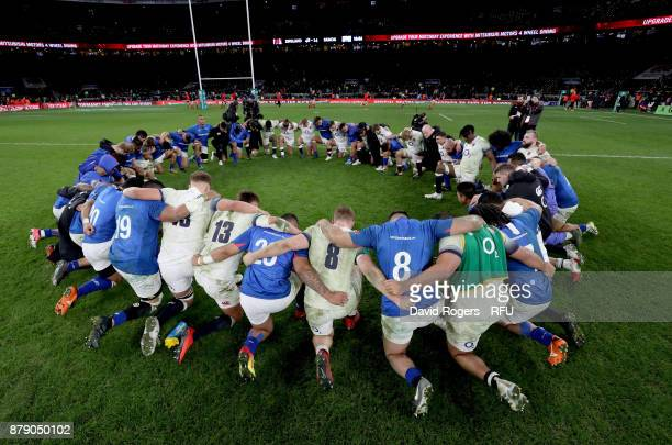 The England and Samoa team huddle together after the Old Mutual Wealth Series match between England and Samoa at Twickenham Stadium on November 25...