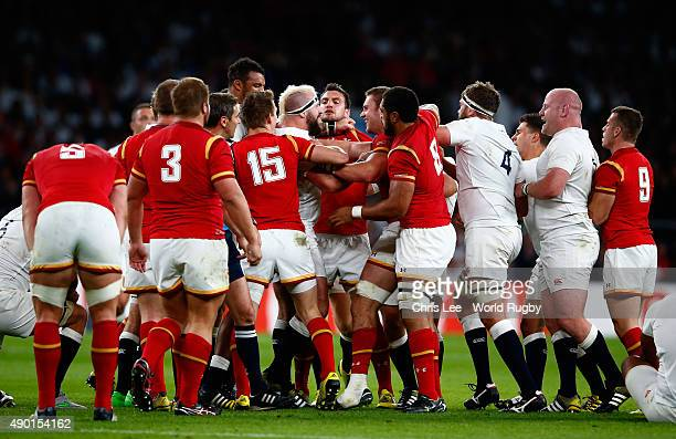 The England and Wales players clash during the 2015 Rugby World Cup Pool A match between England and Wales at Twickenham Stadium on September 26,...
