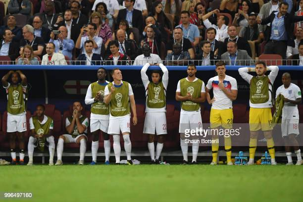 The England bench look dejected following their sides defeat in the 2018 FIFA World Cup Russia Semi Final match between England and Croatia at...