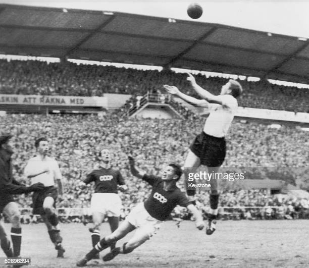 The England centreforward leaps to head the ball and scores England's first goal against Russia in the World Cup at Gothenburg 8th June 1958 England...