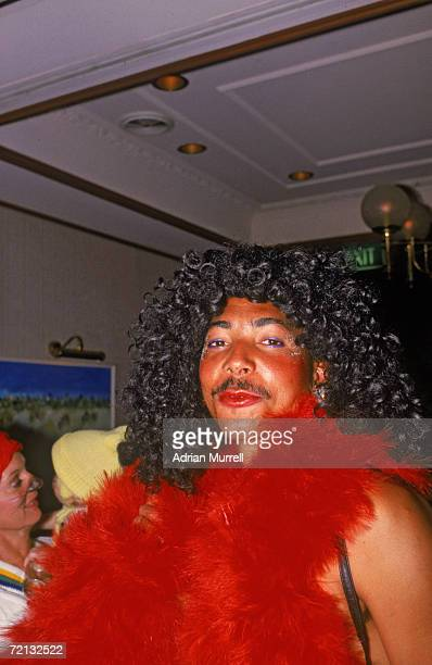 The England cricket team attend a Christmas party during their Australian tour December 1986 Dominicanborn Phil deFreitas sports a red boa and wig