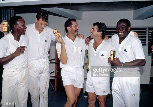 The England cricket team celebrate after beating the West Indies by 9 wickets in the 1st Test Match at Sabina Park in Kingston Jamaica 1st March 1990...