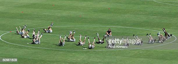 The England fitness coach Ivan Carminati puts the squad through its paces during the training session at the National stadium at their Euro 2004...