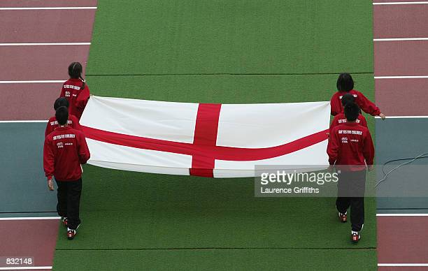 The England flag of St George is led out before the England v Brazil World Cup Quarterfinal Stage match played at the Shizuoka Stadium Ecopa Shizuoka...
