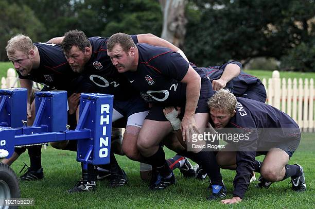 The England front row Dan Cole Steve Thompson and Tim Payne and flank forward Lewis Moody practice their scrummaging during the England training...