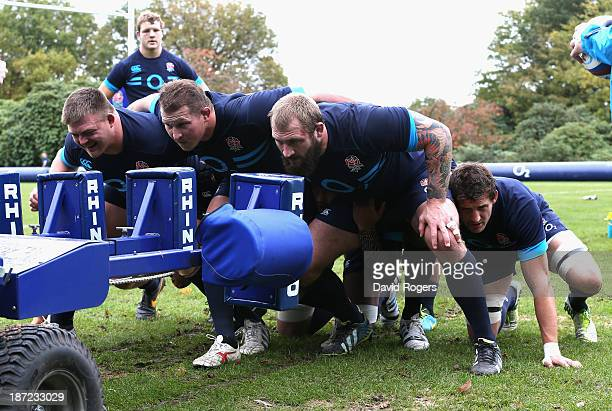 The England front row David Wilson, Dylan Hartley and Joe Marler practice their scrummaging during the England training session at Pennyhill Park on...