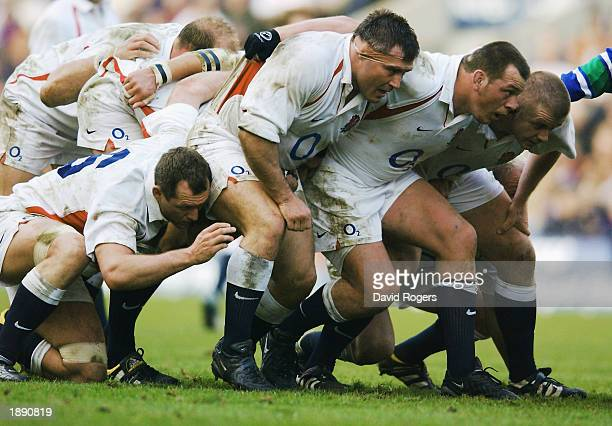 The England front row of Jason Leonard Steve Thompson and Graham Rowntree prepare to scrummage during the RBS Six Nations Championship match between...