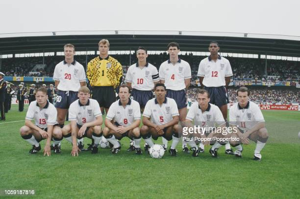 The England national team line up together prior to competing against France in Group 1 of the UEFA Euro 1992 Championship tournament at the Malmo...