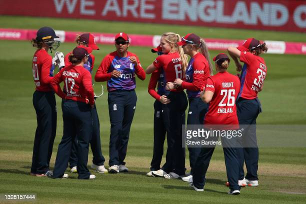 The England players celebrate taking the wicket of Smriti Mandhana caught by Nat Sciver during the Women's Second T20 International match between...