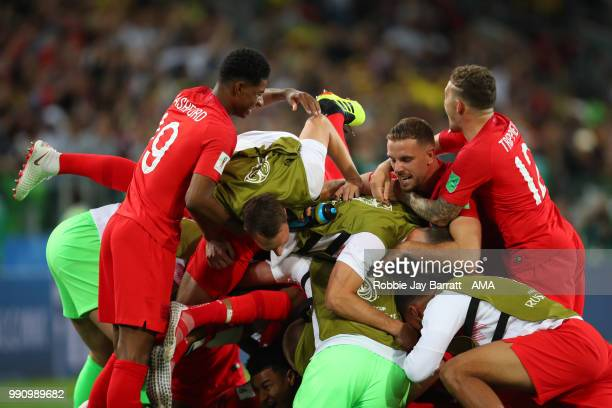 The England players celebrate winning a penalty shootout at the end of extra time during the 2018 FIFA World Cup Russia Round of 16 match between...
