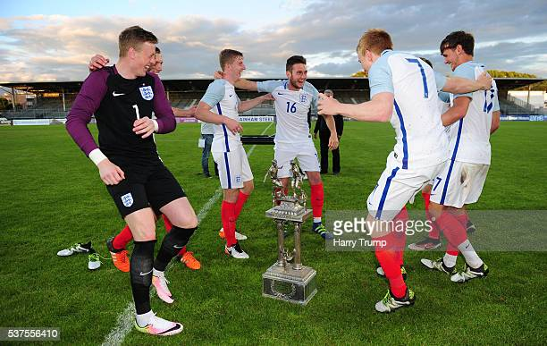 The England players dance around the trophy during the Final of the Toulon Tournament between England and France at Parc Des Sports on May 29, 2016...