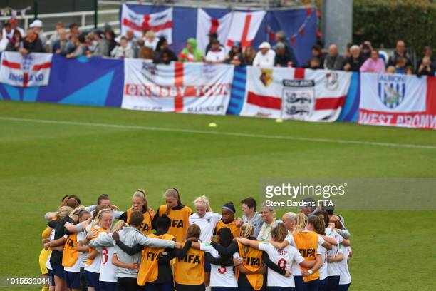 The England players form a huddle after the group B match between England and Mexico at Stade de Marville on August 12 2018 in SaintMalo France