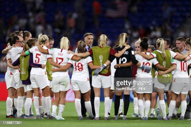 The England players form a team huddle after the 2019 FIFA Women's World Cup France Semi Final match between England and USA at Stade de Lyon on July...