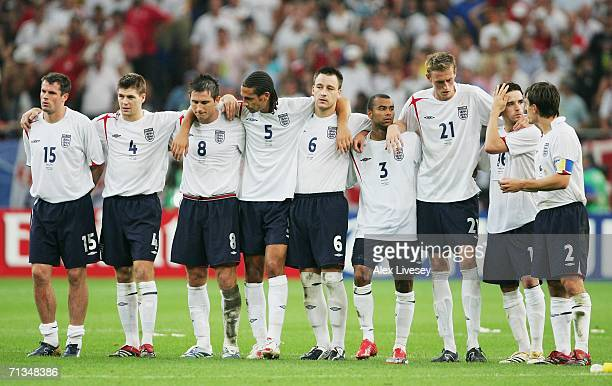The England players line up following Frank Lampard's penalty miss in a penalty shootout during the FIFA World Cup Germany 2006 Quarter-final match...