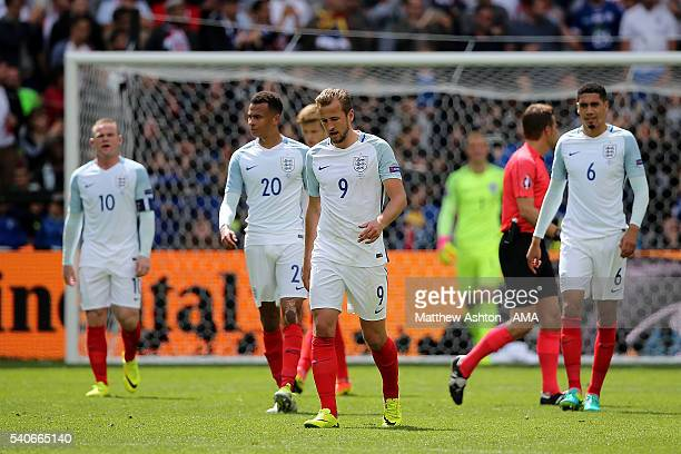 The England players look dejected after Gareth Bale of Wales scores a goal to make the score 01 during the UEFA EURO 2016 Group B match between...