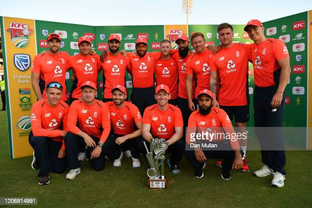 The England players pose with the T20 series trophy following their victory during the Third T20 International match between South Africa and England...