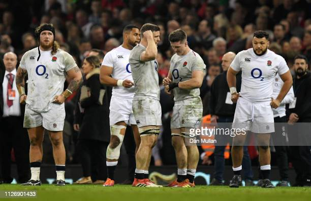 The England players react following defeat in the Guinness Six Nations match between Wales and England at Principality Stadium on February 23 2019 in...