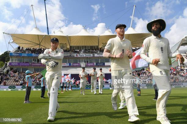 The England players run out through the flag bearers during day two of the 4th Specsavers Test match between England and India at The Ageas Bowl on...