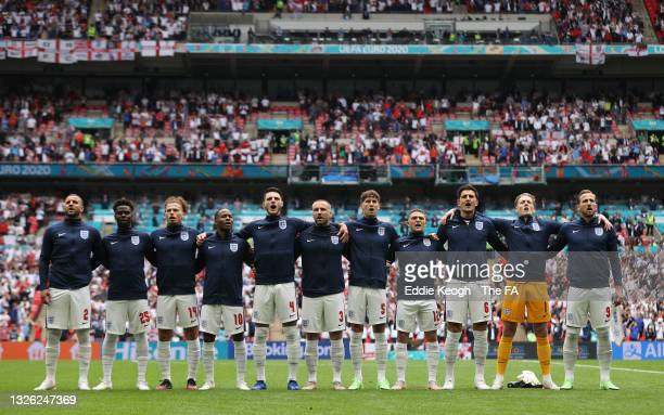 The England players sing the national anthem prior to the UEFA Euro 2020 Championship Round of 16 match between England and Germany at Wembley...