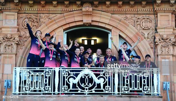 The England side celebrate on the balcony during the ICC Women's World Cup 2017 Final between England and India at Lord's Cricket Ground on July 23...