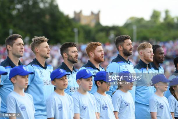 The England side line up for the national anthems during the Group Stage match of the ICC Cricket World Cup 2019 between England and New Zealand at...
