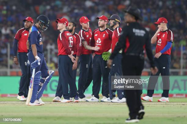 The England side watch the big screen for a third umpire review for the stumping of Virat Kohli of India during the 2nd T20 International match...