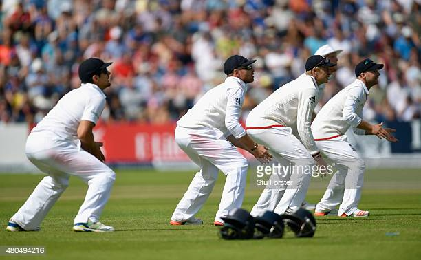 The England slip cordon look on as the helmets lay on the floor unused during day four of the 1st Investec Ashes Test match between England and...
