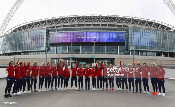 The England squad attempt a 'Mexican Wave' outside the stadium during an England Women Euro 2017 media day at Wembley Stadium on June 5 2017 in...