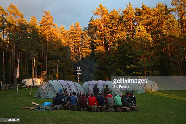 The England squad meet round the camp fire at the England Cricket squad Pre Ashes Training Camp on September 26 2010 near Nuremberg Germany