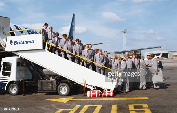 The England squad pose in their double breasted suits on the steps prior to leaving for Italy for the 1990 FIFA World Cup amongst thoise pictured are...