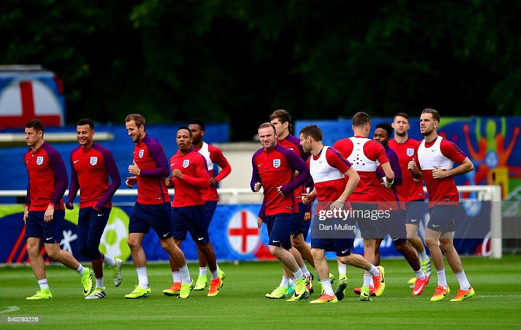 The England squad warm up during a training session at Stade du Bourgognes ahead of the UEFA Euro 2016 match against Wales on June 15, 2016 in Chantilly, France.