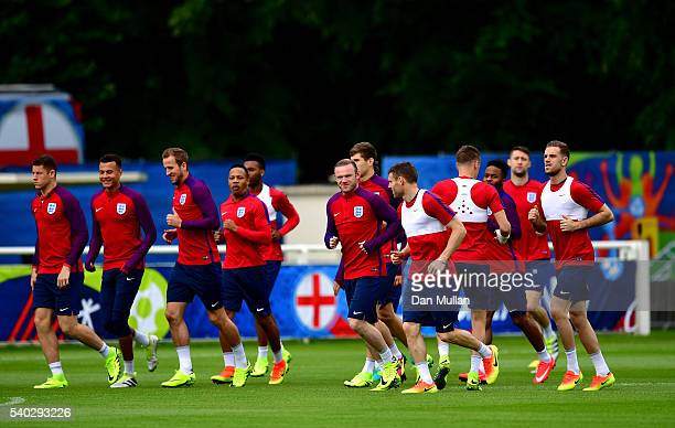 The England squad warm up during a training session at Stade du Bourgognes ahead of the UEFA Euro 2016 match against Wales on June 15 2016 in...