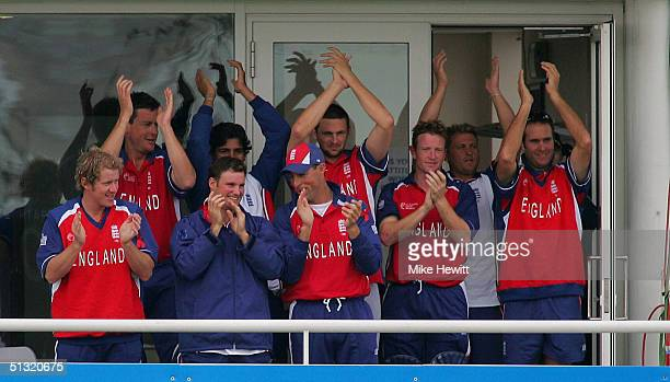 The England team applaud Andrew Flintoff of England for reaching his century during the ICC Champions Trophy match between England and Sri Lanka on...