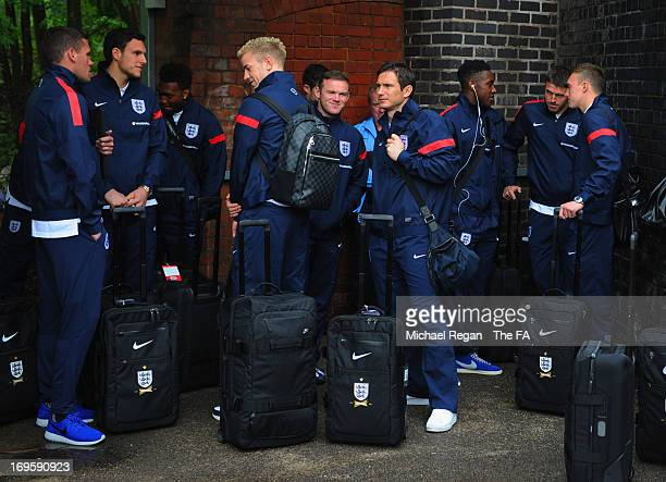 The England team arrive at a train station as the squad travel to London for the England press conference at Sopwell House on May 28, 2013 in St...