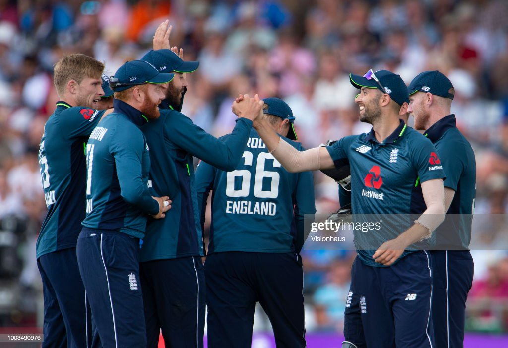 The England team celebrate after Mark Wood catches Rohit Sharma of India during the 3rd Royal London ODI match between England and India at Headingley on July 17, 2018 in Leeds, England.